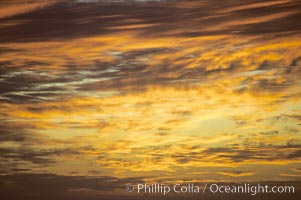 Clouds at sunset, rich warm colors and patterns, Maui