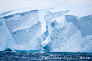 Tabular iceberg.  The edge of a huge tabular iceberg.  Tabular icebergs can be dozens or hundreds of miles in size, have flat tops and sheer sides. Scotia Sea, Southern Ocean, natural history stock photograph, photo id 24793