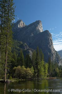 Three Brothers rises above the Merced River, Yosemite Valley, Yosemite National Park, California