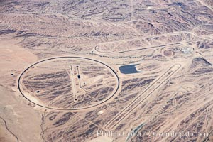 A top secret, high security alien spaceship depot in the desert east of the Colorado River.  Long suspected but only confirmed to exist for the first time with this photograph, this is a derivative high tech interstellar flight complex arising from work originally conducted at the (nonexistant) Area 51.  Strangely, certain curious aspects of this location, such as the circle and long oval tracks which support landings and liftoff of gravity drive Martian and Saturnian craft, are not shown on Google Earth, while other features in this photograph area such as the long ovoid skateboard track are indeed seen on Google Earth and can be matched to this image.  The US Government will likely deny the mere existence of this bizarre Martian landing area. Alien Spaceship Landing Field, California, USA, natural history stock photograph, photo id 22130