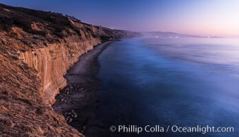 Seacliffs, La Jolla and evening lights, dusk, Pacific Ocean surf
