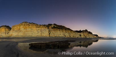 Torrey Pines Cliffs lit at night by a full moon, low tide reflections, Torrey Pines State Reserve, San Diego, California