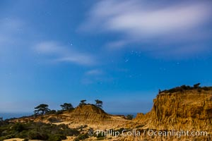 Torrey Pines State Reserve at Night, stars and clouds fill the night sky with the lights of La Jolla visible in the distance. San Diego, California, USA, natural history stock photograph, photo id 28400
