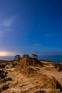 Torrey Pines State Reserve at Night, stars and clouds fill the night sky with the lights of La Jolla visible in the distance. San Diego, California, USA, natural history stock photograph, photo id 28403