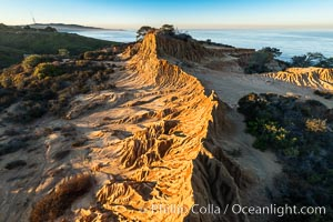 Broken Hill by the first light of dawn, overlooking the Pacific Ocean and Torrey Pines State Reserve, La Jolla and Mount Soledad in the distance, San Diego, California