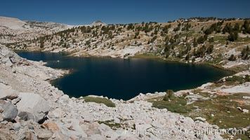 Townsley Lake, viewed from the approach to Hanging Basket Lake, showing the rugged talus slopes that characterize many Sierra Nevada peaks, Yosemite National Park, California