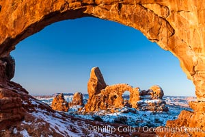 Turret Arch through North Window, winter, sunrise, Arches National Park, Utah
