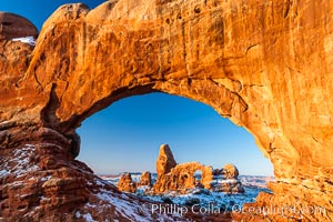 Turret Arch through North Window, winter, sunrise. Arches National Park, Utah, USA, natural history stock photograph, photo id 18120