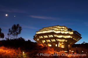 Image 14784, UCSD Library glows at sunset (Geisel Library, UCSD Central Library). University of California, San Diego, La Jolla, California, USA, Phillip Colla, all rights reserved worldwide. Keywords: architecture, books, building, california, campus, college, concrete, cube, design, dusk, education, futuristic, geisel library, la jolla, library, modern, night, outdoors, outside, research, san diego, scene, school, sunset, tourism, travel, ucsd, ucsd library, university, university of california, university of california san diego, usa.