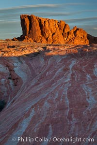 Image 26496, Sandstone striations and butte, dawn. Valley of Fire State Park, Nevada, USA, Phillip Colla, all rights reserved worldwide. Keywords: desert, erosion, geology, hidden location, landscape, natural, nature, nevada, nevada, outdoors, outside, red rock, rock, sandstone, scene, scenery, scenic, valley of fire, valley of fire state park, west.