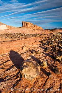 Boulders and sandstone striations, mountain butte, dawn, Valley of Fire State Park