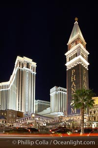 The Venetian Hotel rises above the Strip, Las Vegas Boulevard, at night