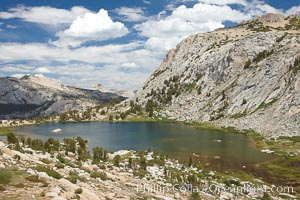 Spectacular Vogelsang Lake in Yosemite's High Sierra, with Fletcher Peak (10319') to the right and Choo-choo ridge in the distance, near Vogelsang High Sierra Camp, Yosemite National Park, California