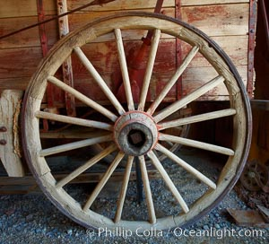 Wagon wheel, in County Barn. Bodie State Historical Park, California, USA, natural history stock photograph, photo id 23154