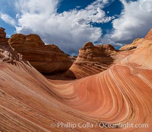 The Wave in the North Coyote Buttes, an area of fantastic eroded sandstone featuring beautiful swirls, wild colors, countless striations, and bizarre shapes set amidst the dramatic surrounding North Coyote Buttes of Arizona and Utah. The sandstone formations of the North Coyote Buttes, including the Wave, date from the Jurassic period. Managed by the Bureau of Land Management, the Wave is located in the Paria Canyon-Vermilion Cliffs Wilderness and is accessible on foot by permit only. USA, natural history stock photograph, photo id 28605