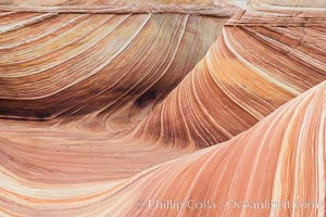 The Wave in the North Coyote Buttes, an area of fantastic eroded sandstone featuring beautiful swirls, wild colors, countless striations, and bizarre shapes set amidst the dramatic surrounding North Coyote Buttes of Arizona and Utah. The sandstone formations of the North Coyote Buttes, including the Wave, date from the Jurassic period. Managed by the Bureau of Land Management, the Wave is located in the Paria Canyon-Vermilion Cliffs Wilderness and is accessible on foot by permit only