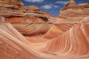 The Wave, an area of fantastic eroded sandstone featuring beautiful swirls, wild colors, countless striations, and bizarre shapes set amidst the dramatic surrounding North Coyote Buttes of Arizona and Utah.  The sandstone formations of the North Coyote Buttes, including the Wave, date from the Jurassic period. Managed by the Bureau of Land Management, the Wave is located in the Paria Canyon-Vermilion Cliffs Wilderness and is accessible on foot by permit only