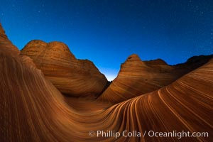 Image 28621, The Wave at Night, under a clear night sky full of stars.  The Wave, an area of fantastic eroded sandstone featuring beautiful swirls, wild colors, countless striations, and bizarre shapes set amidst the dramatic surrounding North Coyote Buttes of Arizona and Utah. The sandstone formations of the North Coyote Buttes, including the Wave, date from the Jurassic period. Managed by the Bureau of Land Management, the Wave is located in the Paria Canyon-Vermilion Cliffs Wilderness and is accessible on foot by permit only. North Coyote Buttes, Paria Canyon-Vermilion Cliffs Wilderness, Arizona, USA