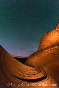 The Wave at Night, under a clear night sky full of stars.  The Wave, an area of fantastic eroded sandstone featuring beautiful swirls, wild colors, countless striations, and bizarre shapes set amidst the dramatic surrounding North Coyote Buttes of Arizona and Utah. The sandstone formations of the North Coyote Buttes, including the Wave, date from the Jurassic period. Managed by the Bureau of Land Management, the Wave is located in the Paria Canyon-Vermilion Cliffs Wilderness and is accessible on foot by permit only. North Coyote Buttes, Paria Canyon-Vermilion Cliffs Wilderness, Arizona, USA, natural history stock photograph, photo id 28623