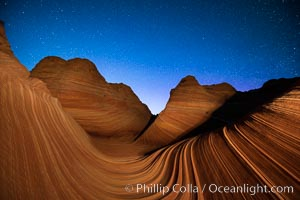The Wave at Night, under a clear night sky full of stars.  The Wave, an area of fantastic eroded sandstone featuring beautiful swirls, wild colors, countless striations, and bizarre shapes set amidst the dramatic surrounding North Coyote Buttes of Arizona and Utah. The sandstone formations of the North Coyote Buttes, including the Wave, date from the Jurassic period. Managed by the Bureau of Land Management, the Wave is located in the Paria Canyon-Vermilion Cliffs Wilderness and is accessible on foot by permit only. North Coyote Buttes, Paria Canyon-Vermilion Cliffs Wilderness, Arizona, USA, natural history stock photograph, photo id 28626