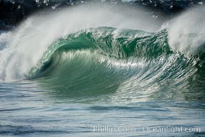 A large, powerful wave breaks with offshore winds at the Wedge in Newport Beach, The Wedge