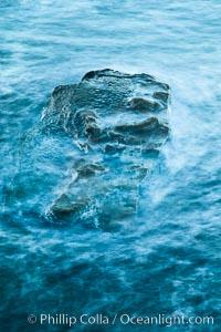 Waves wash over coast rocks, La Jolla, California