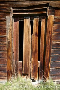 Weathered and broken old door, Kelley Building on Green Street. Bodie State Historical Park, California, USA, natural history stock photograph, photo id 23109