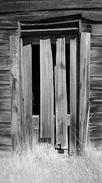 Weathered and broken old door, Kelley Building on Green Street, Bodie State Historical Park, California