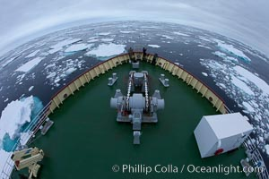 Pack ice and brash ice fills the Weddell Sea, near the Antarctic Peninsula.  This pack ice is a combination of broken pieces of icebergs, sea ice that has formed on the ocean. Weddell Sea, Southern Ocean, natural history stock photograph, photo id 24842