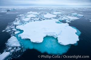 Pack ice and brash ice fills the Weddell Sea, near the Antarctic Peninsula.  This pack ice is a combination of broken pieces of icebergs, sea ice that has formed on the ocean. Weddell Sea, Southern Ocean, natural history stock photograph, photo id 24844