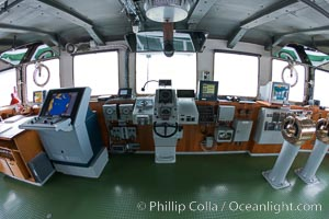 Wheelhouse of the ship M/V Polar Star, with navigation equipment, helm controls, communications, and a great view., natural history stock photograph, photo id 23713