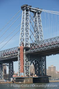 The Williamsburg Bridge viewed from the East River.  The Williamsburg Bridge is a suspension bridge in New York City across the East River connecting the Lower East Side of Manhattan at Delancey Street with the Williamsburg neighborhood of Brooklyn on Long Island at Broadway near the Brooklyn-Queens Expressway