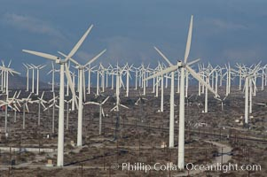 Image 06914, Wind turbines provide electricity to Palm Springs and the Coachella Valley. San Gorgonio pass, San Bernardino mountains. San Gorgonio Pass, Palm Springs, California, USA, Phillip Colla, all rights reserved worldwide. Keywords: california, coachella valley, desert, electricity, energy, palm springs, power generation, san gorgonio pass, san gorgonio pass wind farm, science and technology, usa, wind farm, wind power, wind turbine, windmill.
