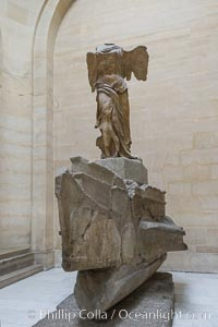 The Winged Victory of Samothrace, also called the Nike of Samothrace, is a 2nd century BC marble sculpture of the Greek goddess Nike (Victory). The Nike of Samothrace, discovered in 1863, is estimated to have been created around 190 BC. Musee du Louvre, Paris, France, natural history stock photograph, photo id 28103