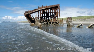Wreck of the Peter Iredale, rusting away in the sand at the ocean's edge, Fort Stevens State Park, Oregon