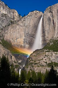 Upper Yosemite Falls and lunar rainbow, moonbow. A lunar rainbow (moonbow) can be seen to the left of Yosemite Falls, where the moon illuminates the spray of the falls, Yosemite National Park, California