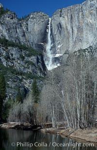 Yosemite Falls viewed from swinging bridge over Merced River, winter, Yosemite Valley, Yosemite National Park, California