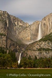 Yosemite Falls by moonlight, viewed from Cooks Meadow. Yosemite Valley, Yosemite National Park, California