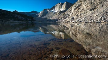 Cathedral Range peaks reflected in the still waters of Townsley Lake, Yosemite National Park, California