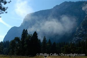 Dust rises above Yosemite Valley following a landslide near Three Brothers. October 2003, Yosemite National Park, California