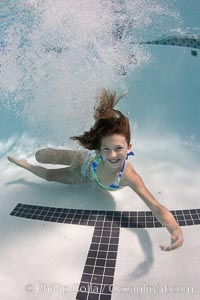 Young girl swimming in a pool