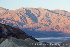 Zabriskie Point, sunrise.  Curiously banded area of sedimentary rock lies in the foreground with the Panamint Mountains visible in the distance, Death Valley National Park, California