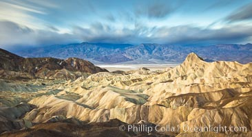 Zabriskie Point sunrise, clouds blurred by long time exposure, Death Valley National Park, California