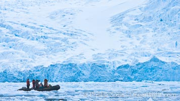 Zodiac cruising in Antarctica.  Tourists enjoy the pack ice and towering glaciers of Cierva Cove on the Antarctic Peninsula. Cierva Cove, Antarctic Peninsula, Antarctica, natural history stock photograph, photo id 25529