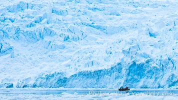 Zodiac cruising in Antarctica.  Tourists enjoy the pack ice and towering glaciers of Cierva Cove on the Antarctic Peninsula