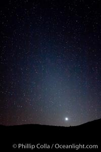 Zodiacal light over Death Valley.  Zodiacal light is a faint diffuse light seen along the plane of the ecliptic in the vicinity of the setting or rising sun, caused by sunlight scattered off space dust in the zodiacal cloud. Racetrack Playa, Death Valley National Park, California, USA, natural history stock photograph, photo id 27692