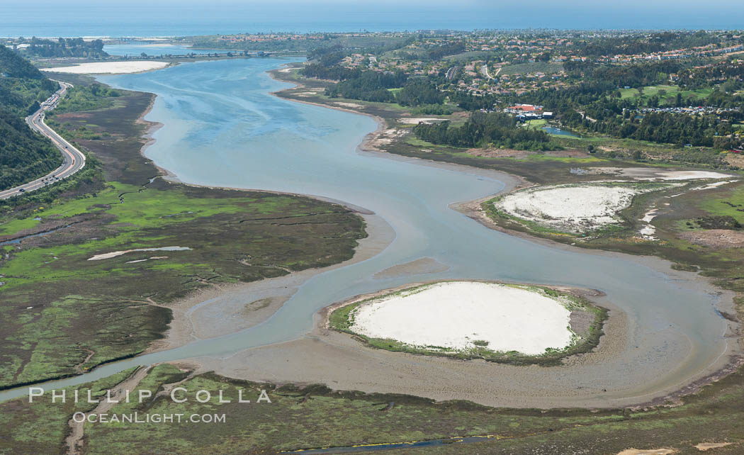 Aerial photo of Batiquitos Lagoon, Carlsbad. The Batiquitos Lagoon is a coastal wetland in southern Carlsbad, California. Part of the lagoon is designated as the Batiquitos Lagoon State Marine Conservation Area, run by the California Department of Fish and Game as a nature reserve. Callifornia, USA, natural history stock photograph, photo id 30563