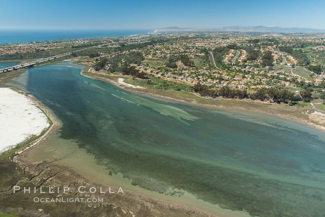 Image 30561, Aerial photo of Batiquitos Lagoon, Carlsbad. The Batiquitos Lagoon is a coastal wetland in southern Carlsbad, California. Part of the lagoon is designated as the Batiquitos Lagoon State Marine Conservation Area, run by the California Department of Fish and Game as a nature reserve. Carlsbad, Callifornia, USA