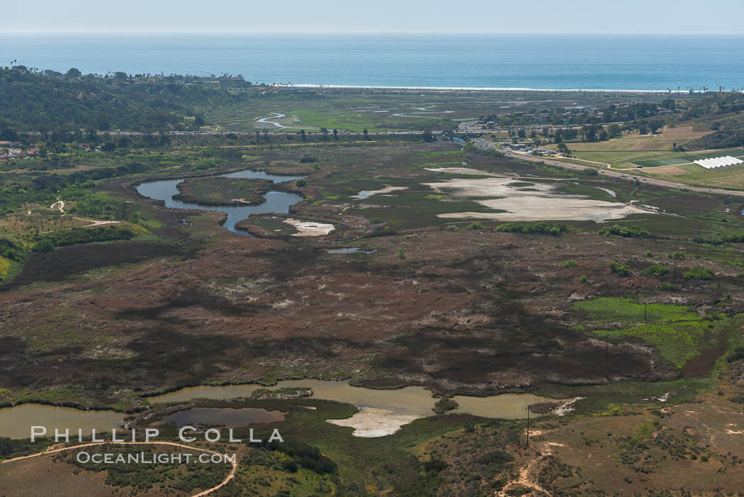 Aerial Photo of San Elijo Lagoon. San Elijo Lagoon Ecological Reserve is one of the largest remaining coastal wetlands in San Diego County, California, on the border of Encinitas, Solana Beach and Rancho Santa Fe. USA, natural history stock photograph, photo id 30590