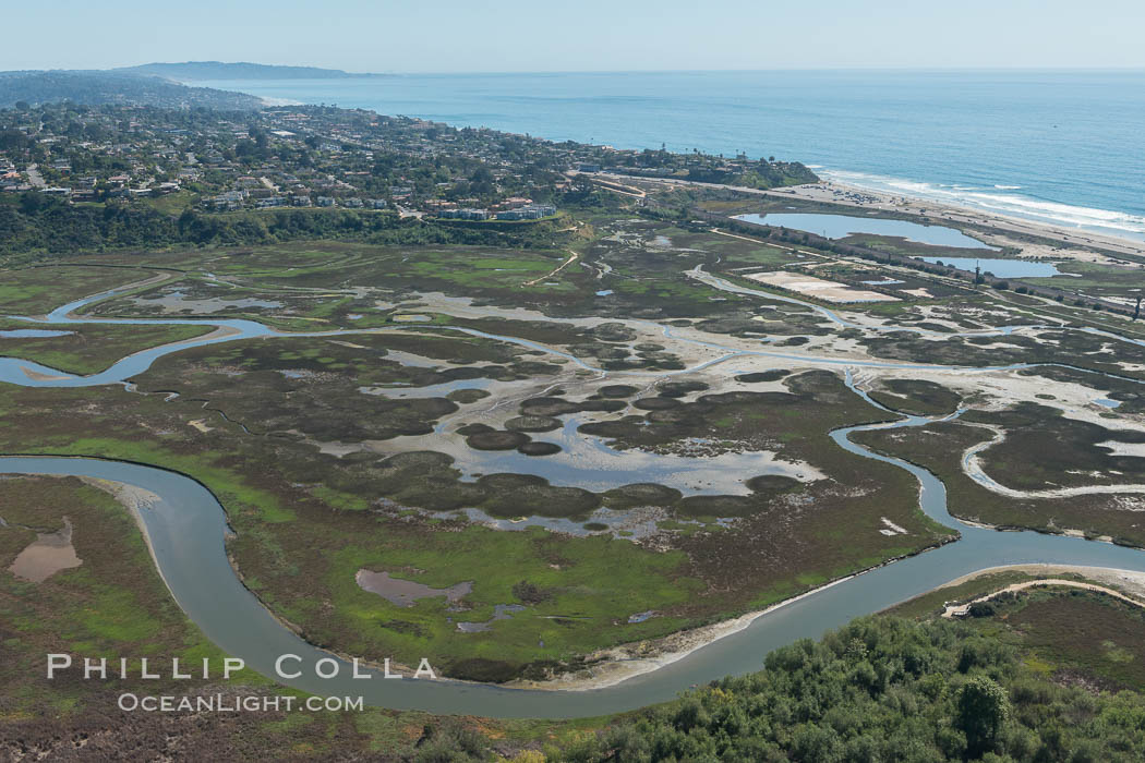 Image 30592, Aerial Photo of San Elijo Lagoon. San Elijo Lagoon Ecological Reserve is one of the largest remaining coastal wetlands in San Diego County, California, on the border of Encinitas, Solana Beach and Rancho Santa Fe. Encinitas, California, USA, Phillip Colla, all rights reserved worldwide. Keywords: above, aerial, aerial photo, aerial photograph, aloft, california, coast, encinitas, lagoon, lighthawk, marine, marine protected area, marsh, mpa, ocean, outdoors, outside, san diego, san elijo lagoon, san elijo lagoon ecological reserve, scene, scenery, scenic, usa, wetland.
